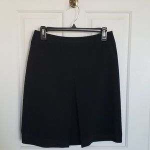 Skirt with front pleat